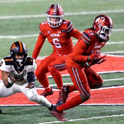 Utah Utes safety Vonte Davis (19) makes an interception in front of Oregon State Beavers wide receiver Kolby Taylor (5) as Utah and Oregon State play a college football game at Rice-Eccles Stadium in Salt Lake City on Saturday, Dec. 5, 2020.