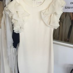 White silk cocktail dress with organza sleeve detail, $100