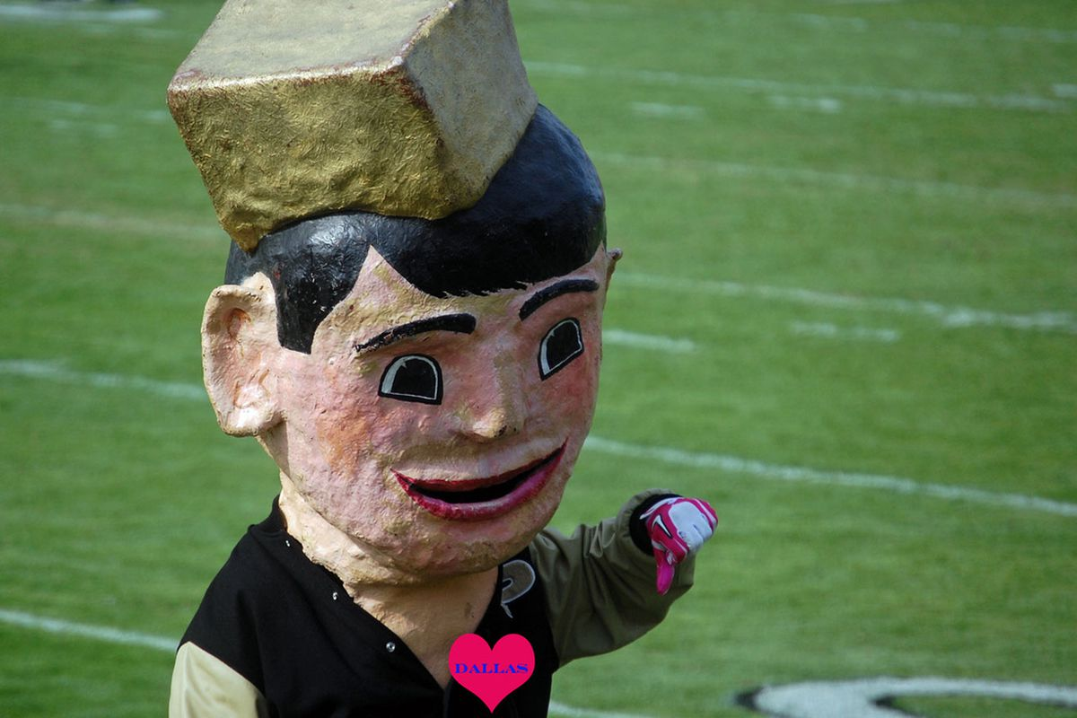 Old Pete's thumbs down gesture doesn't have anything to do with the Heart of Dallas Bowl. Also, that is a fake heart.