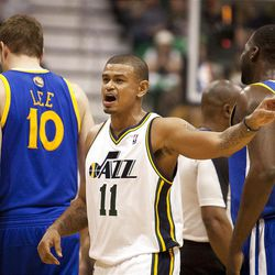 Jazz guard Earl Watson (11) motions for a set play during the first half of the NBA basketball game between the Utah Jazz and the Golden State Warriors at Energy Solutions Arena, Wednesday, Dec. 26, 2012.