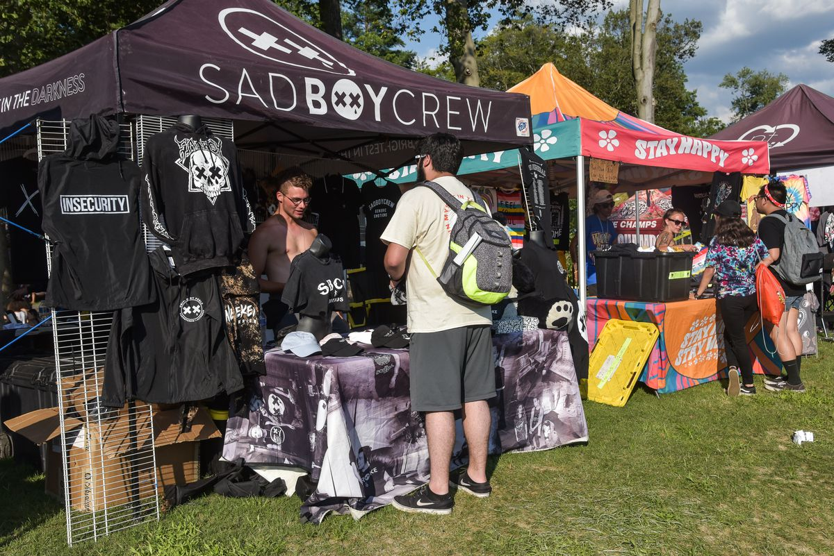 Lots and lots of stuff — from brands, bands, and nonprofits — is available at the Warped Tour booths.