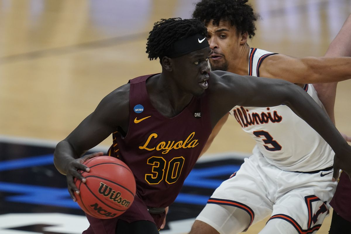 Loyola forward Aher Uguak (30) drives on Illinois guard Jacob Grandison (3) during the second half of Sunday's NCAA Tournament game.