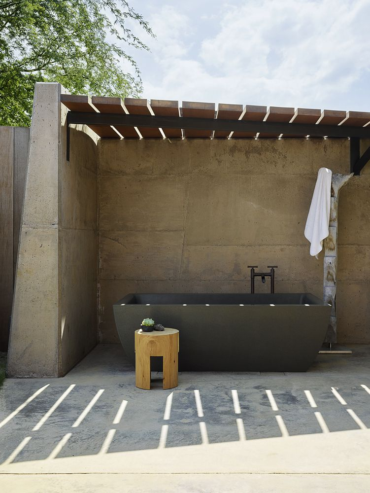 Outdoor covered bathtub.