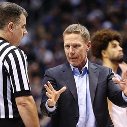 Gonzaga Bulldogs head coach Mark Few talks with a referee as BYU and Gonzaga play in an NCAA basketball game in the Marriott Center in Provo on Saturday, Feb. 24, 2018. Gonzaga won 79-65.