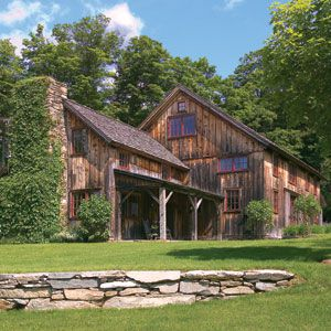 <p>The rustic exterior of Roy Reardon and Patricia Hyne's guest house was left intact in its conversion from horse barn to house, which was designed by Robert Dean Architects.</p>