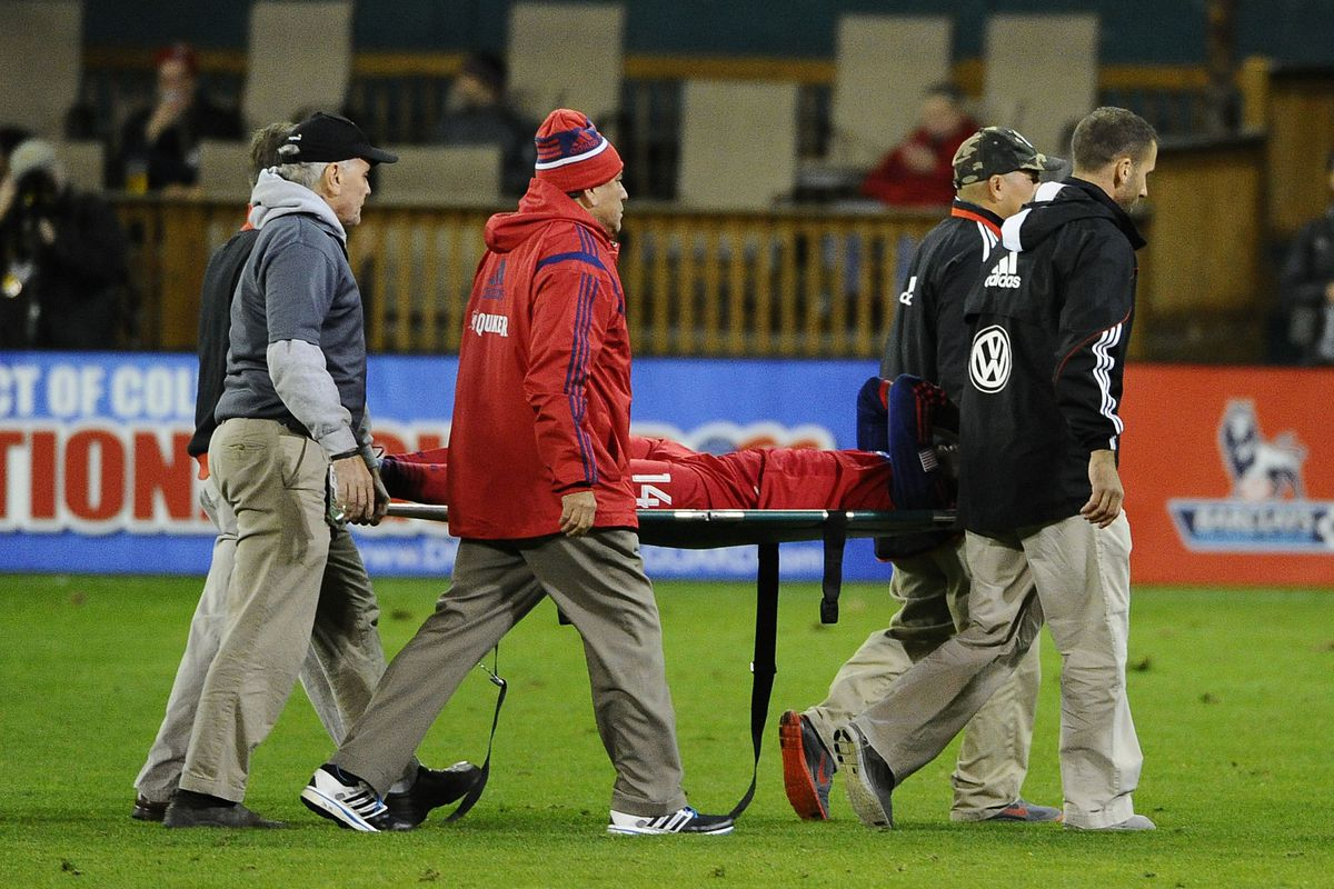 Physios and field crew carry Fire winger Patrick Nyarko from the field after his injury just a few minutes into a substitute appearance Saturday night. Nyarko's injury defanged the Fire's comeback attempt.