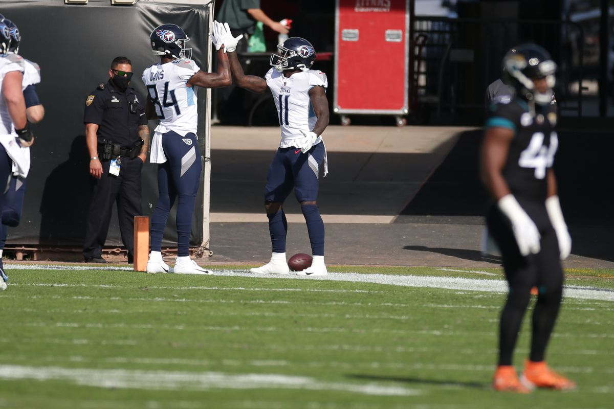 Tennessee Titans Wide Receiver A.J. Brown (11) celebrates a touchdown with Tennessee Titans Wide Receiver Corey Davis (84) during the game between the Tennessee Titans and the Jacksonville Jaguars on December 13, 2020 at TIAA Bank Field in Jacksonville, Fl.