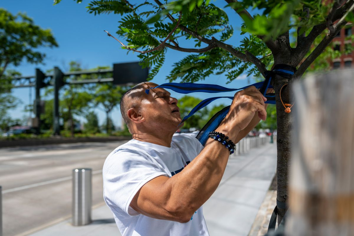 Republican mayoral candidate Fernando Mateo tied Blued Lives Matter ribbons around the 9/11 memorial, May 27, 2021.