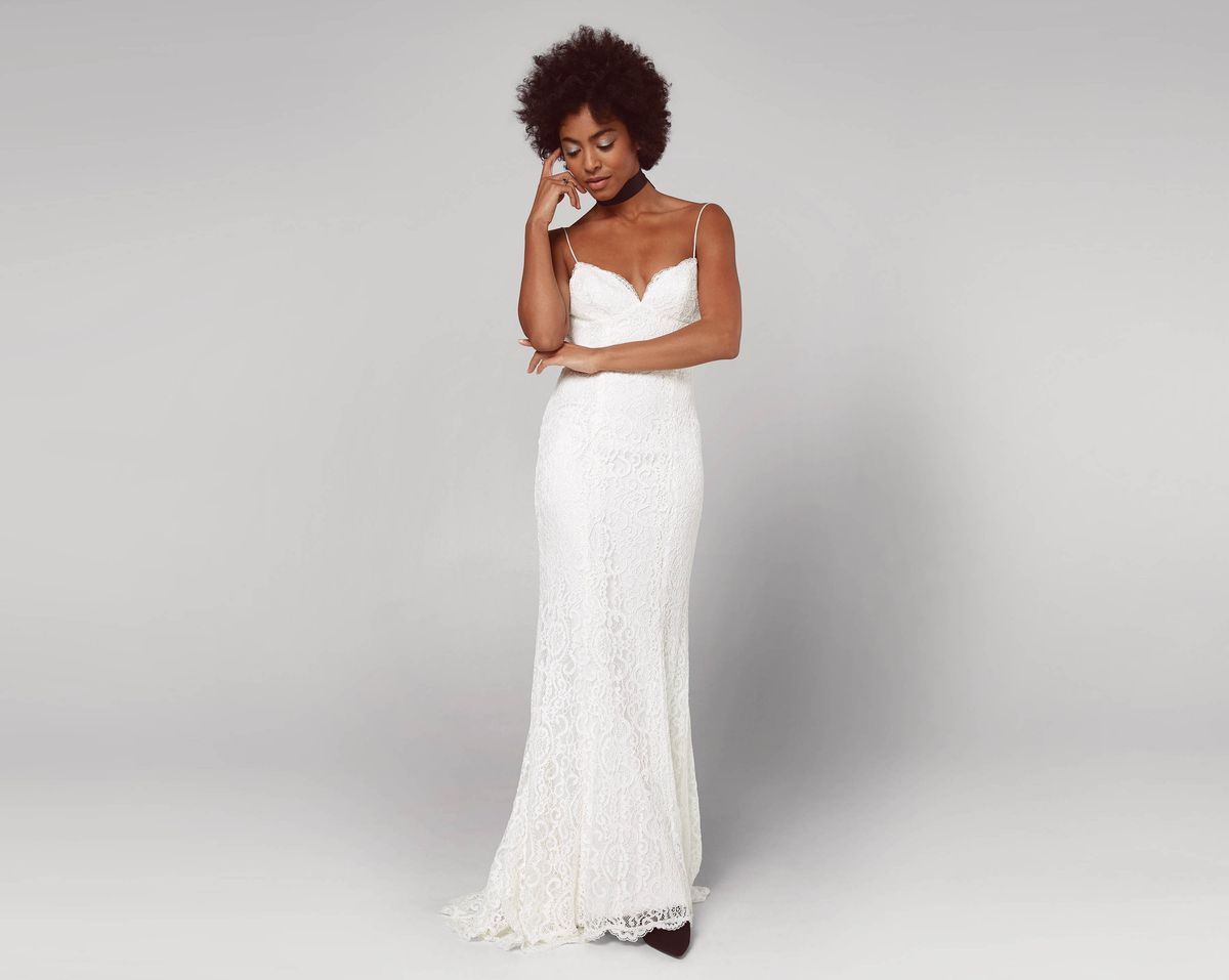 Inexpensive pretty wedding dresses for under 1000 racked a model wearing a white wedding gown with spaghetti straps and a sweetheart neckline junglespirit Image collections