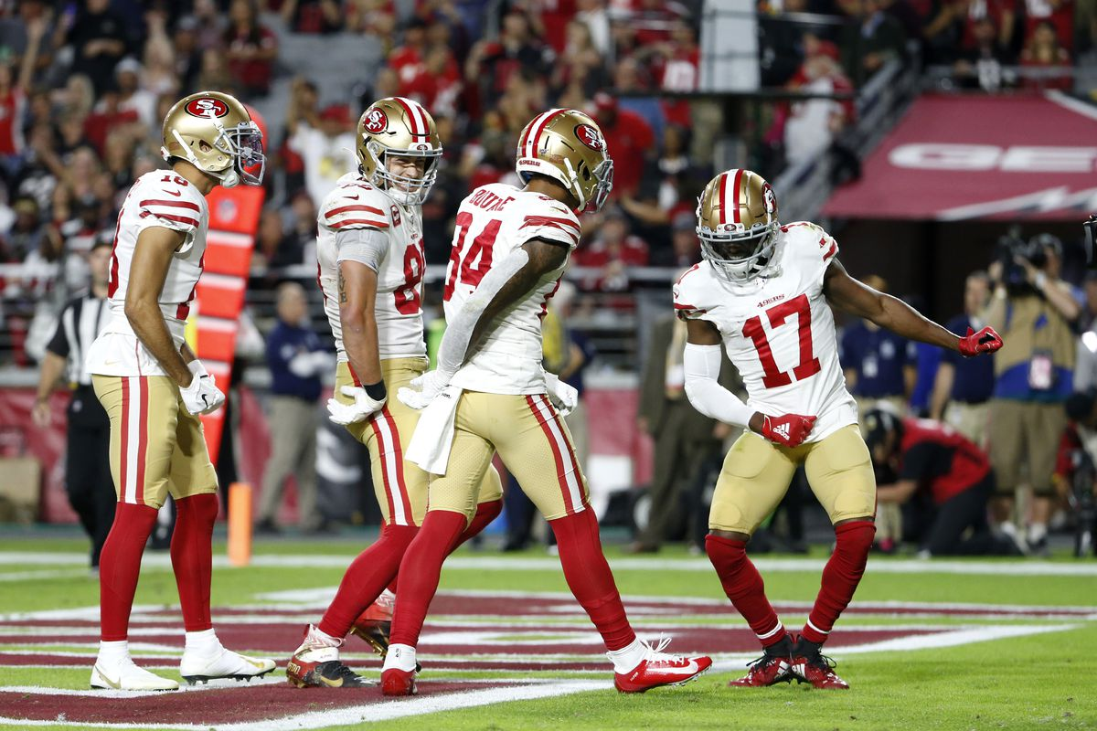 Wide receivers Kendrick Bourne and Emmanuel Sanders of the San Francisco 49ers do an end zone dance with teammates George Kittle and Dante Pettis after Bourne's touchdown catch against the Arizona Cardinals on October 31, 2019 in Glendale, Arizona.