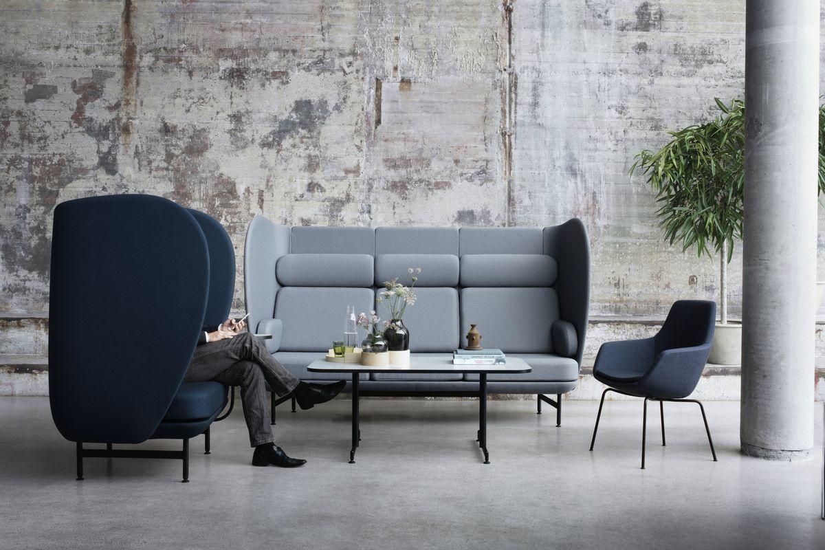 Blue sofas seated around coffee table