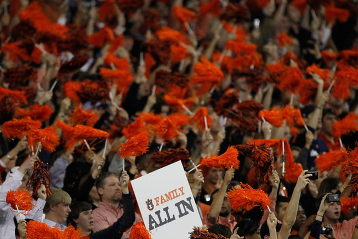 ATLANTA GA - DECEMBER 04:  Fans of the Auburn Tigers cheer against the South Carolina Gamecocks during the 2010 SEC Championship at Georgia Dome on December 4 2010 in Atlanta Georgia.  (Photo by Kevin C. Cox/Getty Images)