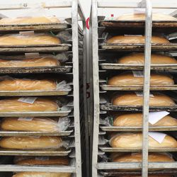 Schmidt's Pastry Cottage bread sits on shelves ready to be handed out during a Free Bread Project giveaway at Cyprus High School in Magna on Sunday, May 17, 2020.