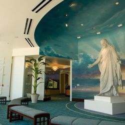 An 11-foot Christus statue adorns the entrance to the Los Angeles Temple Visitors' Center.