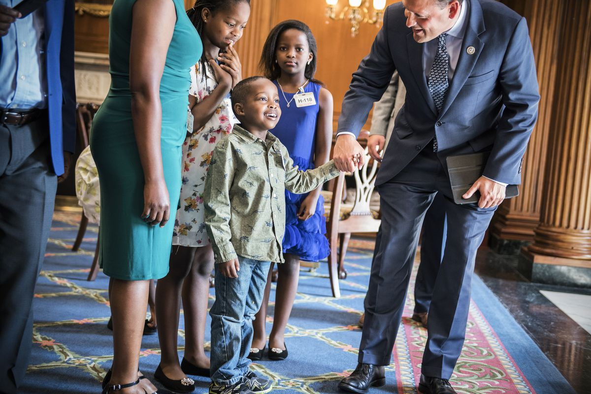 Rep. Andy Barr (R-Ky.), gives a tour of Capitol's Rayburn Room to constituent Alpha Fayida, 6, who was born in the US and whose family, originally from Rwanda, recently became U.S. citizens, on July 13, 2018.