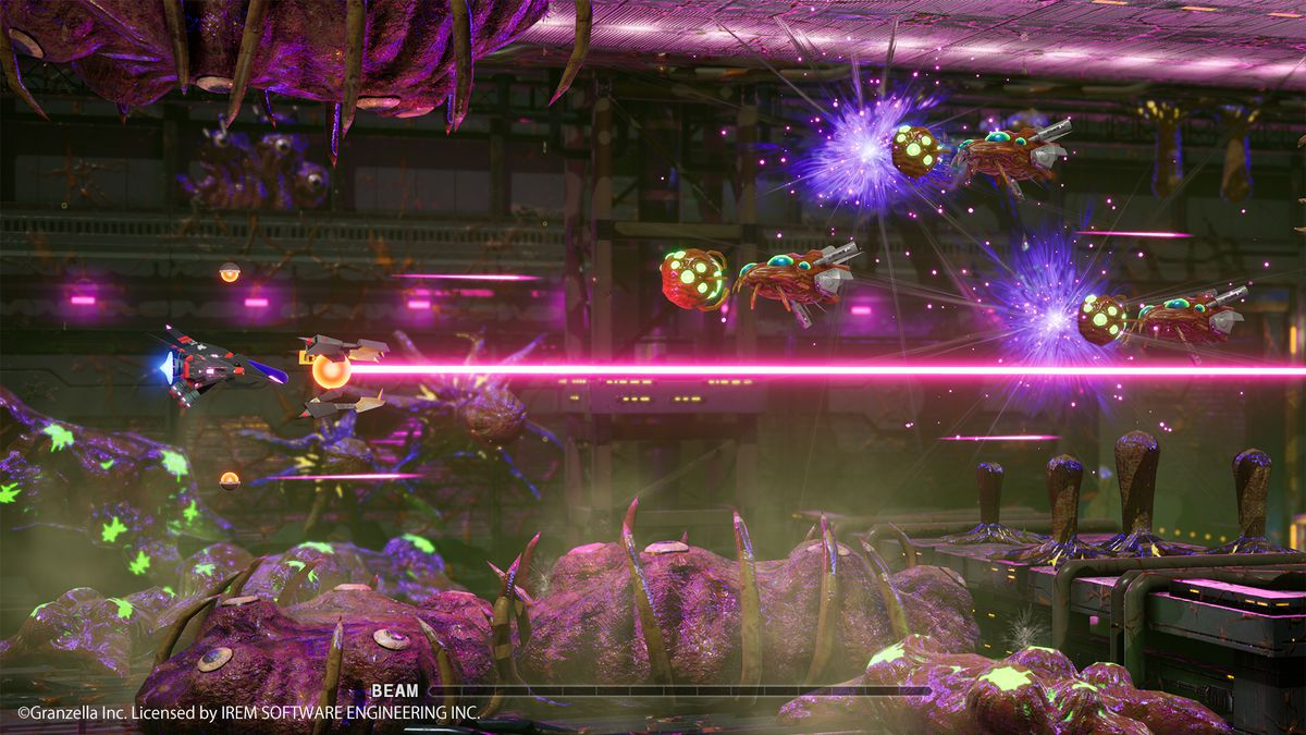 a spaceship fires a magenta laser beam horizontally in R-Type Final 2