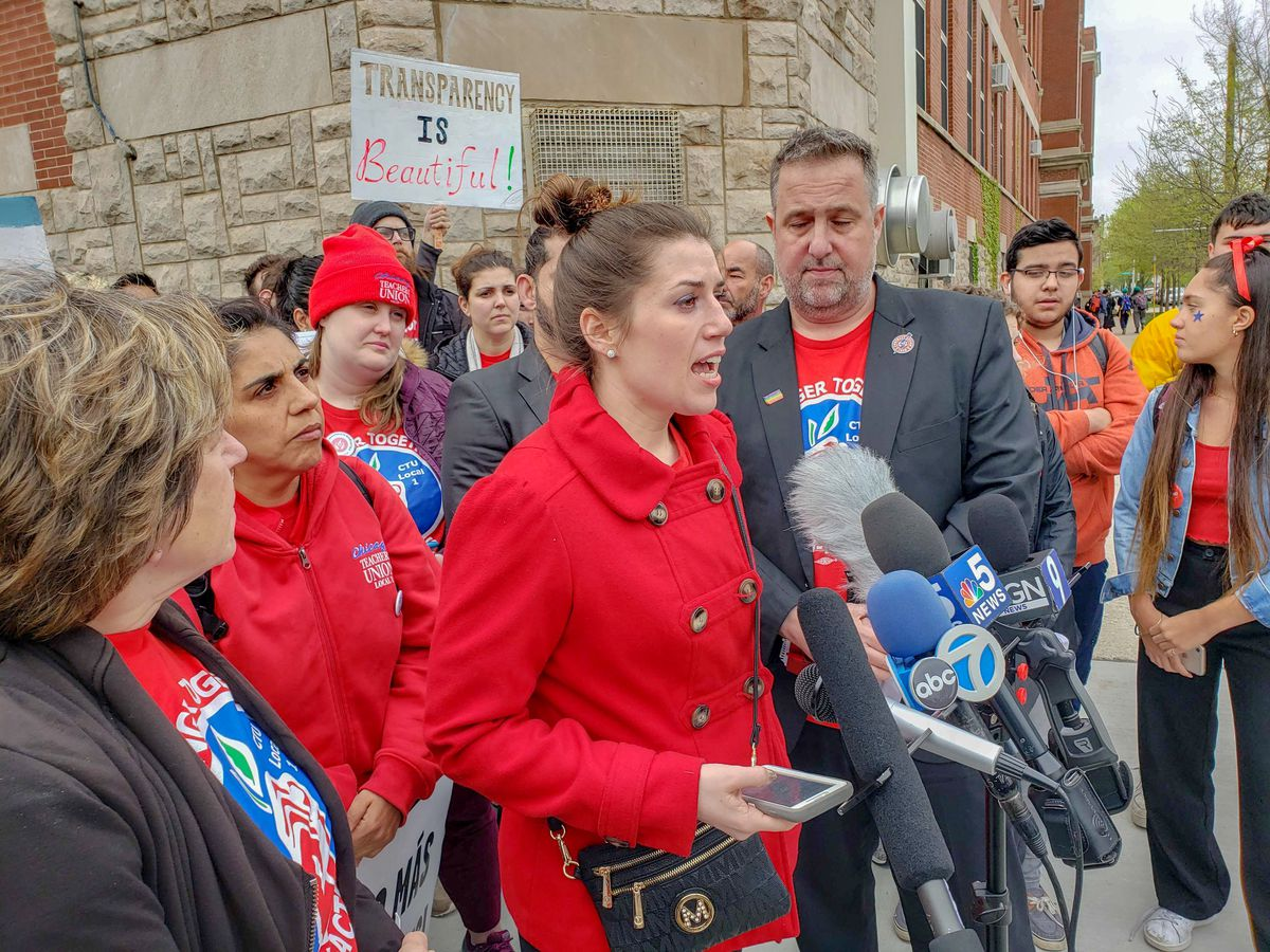 Teacher Carlene Carpenter speaks to reporters at a CTU rally ahead of a planned strike.   Nader Issa/Sun-Times