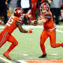 Utah Utes running back Ty Jordan (22) takes the handoff from Utah Utes quarterback Jake Bentley (8) as Utah and Oregon State play a college football game at Rice Eccles stadium in Salt Lake City on Sunday, Dec. 6, 2020. Utah won 30-24.
