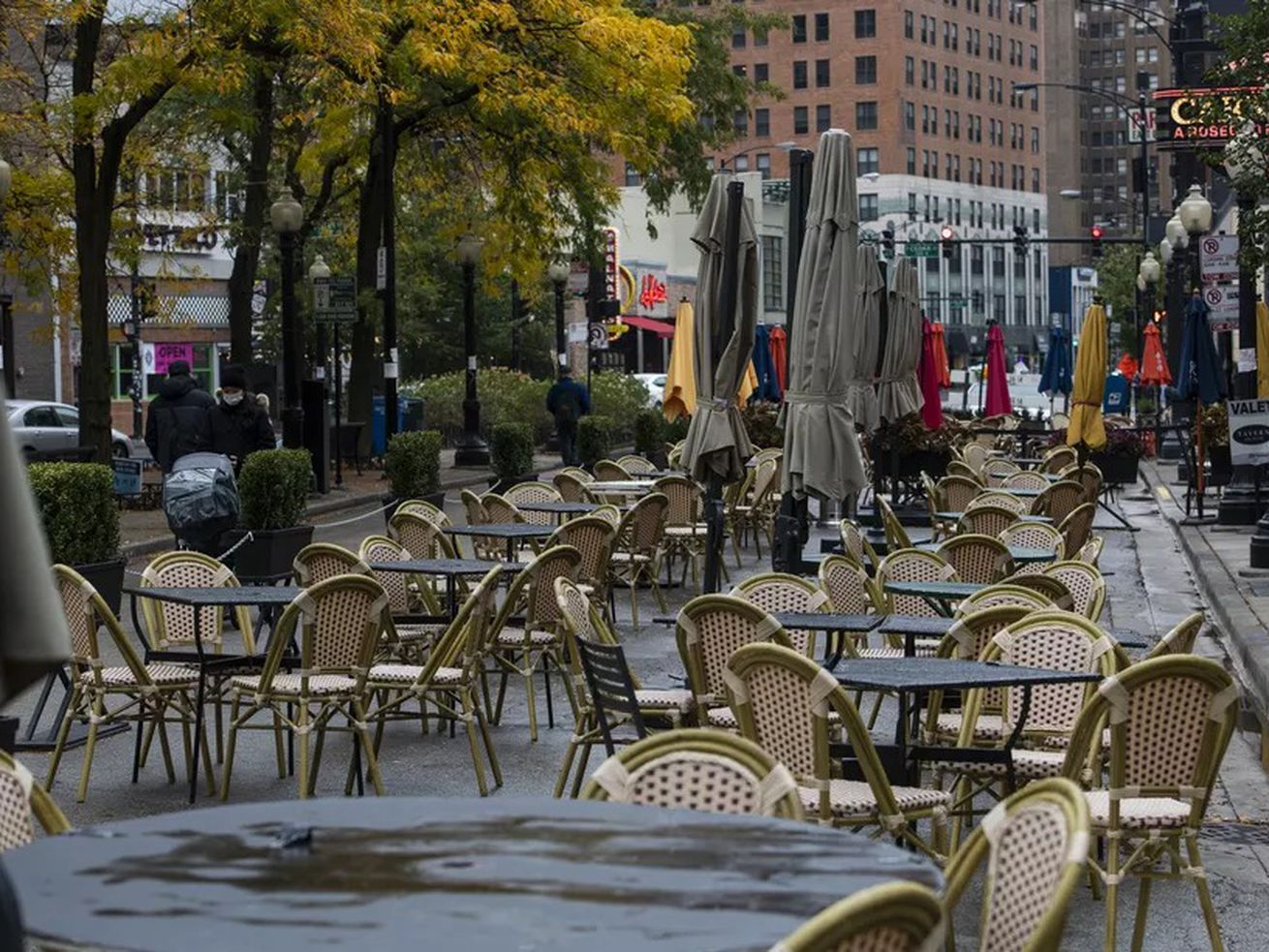 Tables sit empty outside Tavern On Rush and Carmine's on a chilly Tuesday.