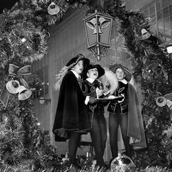 Temple Square sparkles with 100,000 lights, and scenes of shepherds and the Nativity, on Dec. 9, 1967.__Musicians serenaded Christmas Eve shoppers on Main Street, December 1987.__President David O. McKay and Pres. N. Eldon Tanner open the first lighting of lights on Temple Square, Dec. 18, 1965.