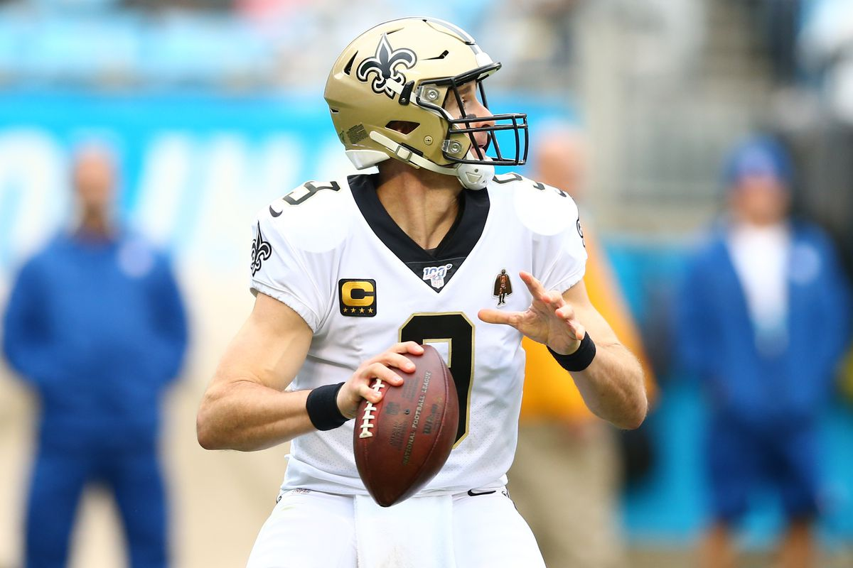 New Orleans Saints quarterback Drew Brees looks to pass during the third quarter against the Carolina Panthers at Bank of America Stadium.