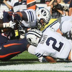 Virginia running back Kevin Parks (25) is tackled by members of the cougar defense as BYU and Virginia to play Saturday, Sept. 20, 2014, at LaVell Edwards Stadium in Provo. BYU won 41-33.