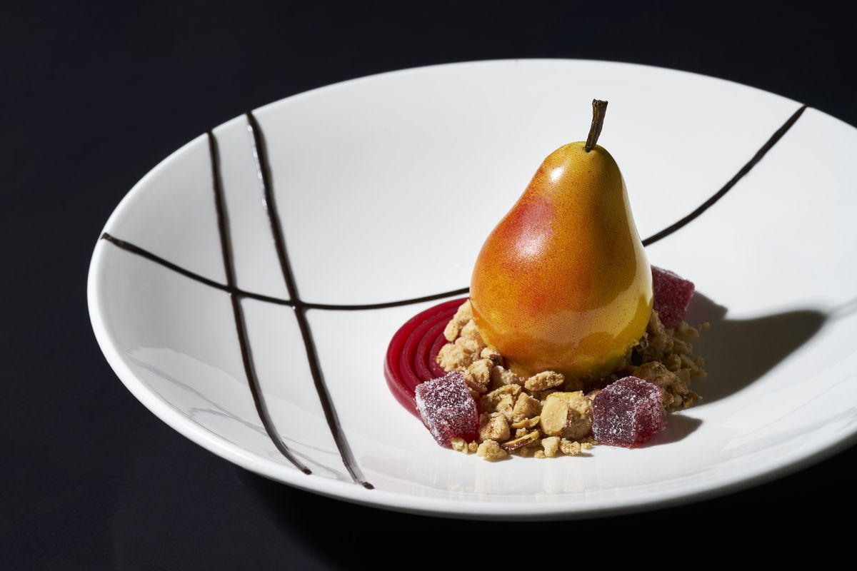 Pastry Chef Marionela Tirsina's desserts include a Pear William, withpear marmalade and pear ganache balanced on a crispy gingerbread biscuit