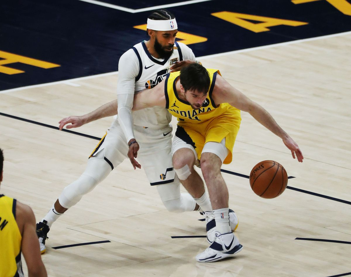 Utah Jazz guard Mike Conley (10) defends Indiana Pacers guard T.J. McConnell (9)during a game at the Vivint Arena in Salt Lake City on Friday, April 16, 2021.