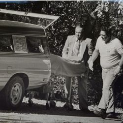 The body of Kathleen Webb Sheets is taken from her home. She was killed Oct. 15, 1985, by a bomb in Holladay.