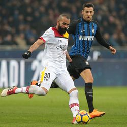 Sandro (front) of Benevento Calcio is challenged by Matias Vecino of FC Internazionale Milano during the serie A match between FC Internazionale and Benevento Calcio at Stadio Giuseppe Meazza on February 24, 2018 in Milan, Italy.