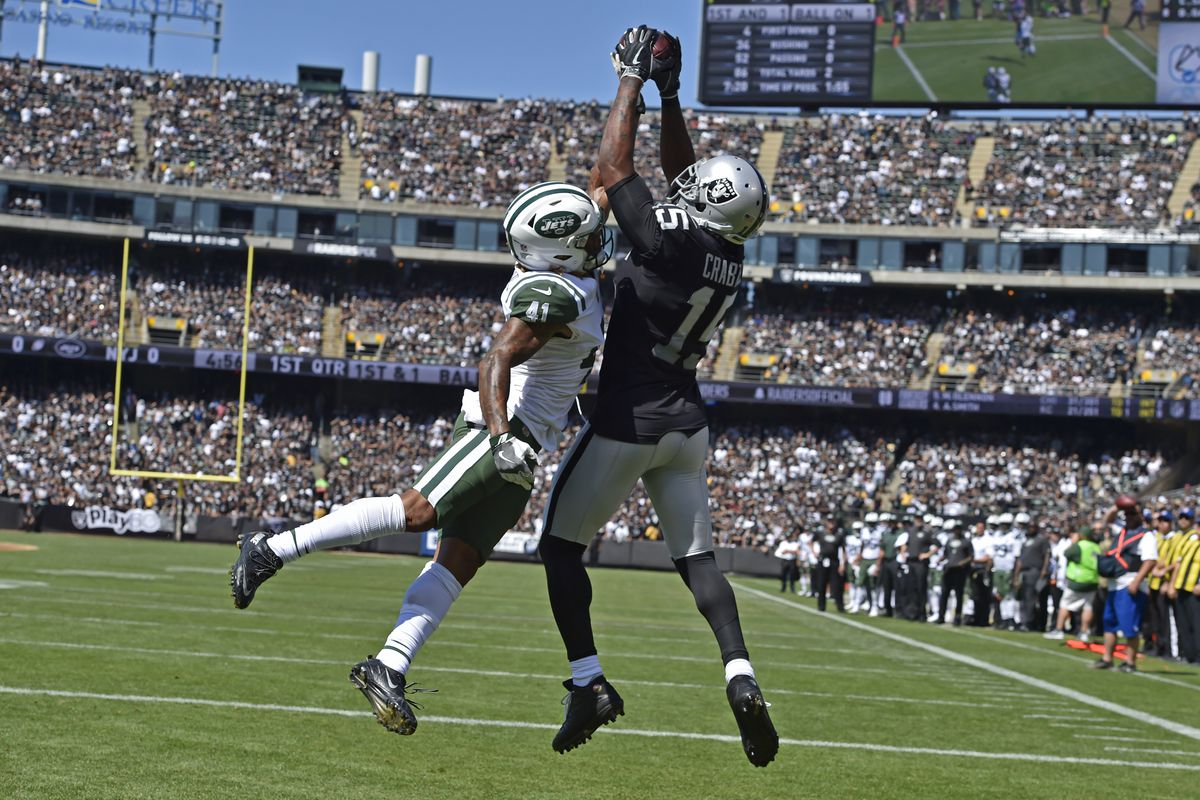 Oakland Raiders' Michael Crabtree (15) reaches to grab a touchdown pass in front of New York Jets' Buster Skrine (41) in the first quarter of their NFL game at the Oakland Coliseum in Oakland, Calif. on Sunday, Sept. 17, 2017. (Jose Carlos Fajardo/Bay Are