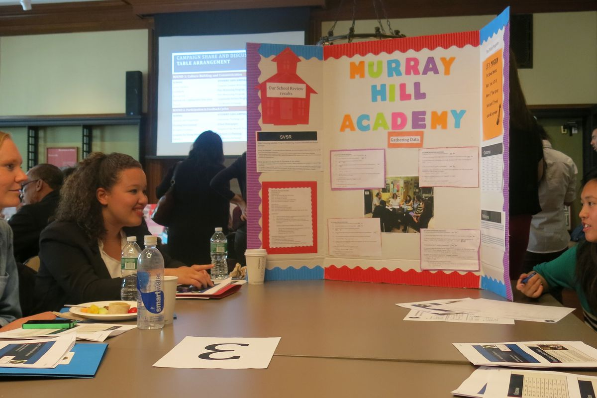 Cristal Cruz, second from left, and Salina Kuoc, right, discuss a mentoring project.