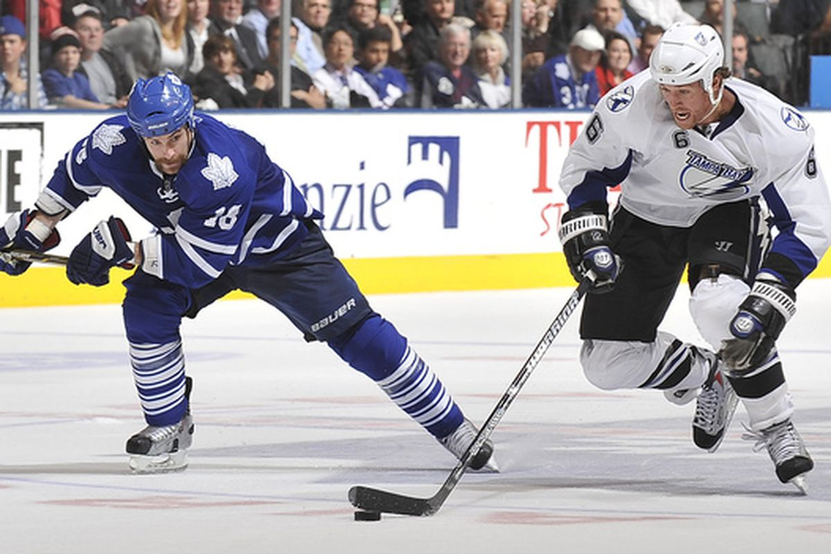 TORONTO CANADA - NOVEMBER 30:  Mike Brown #18 of the Toronto Maple Leafs skates after Ryan Malone #6 of the Tampa Bay Lightning during game action November 30 2010 at the Air Canada Centre in Toronto Ontario Canada. (Photo by Abelimages/Getty Images)