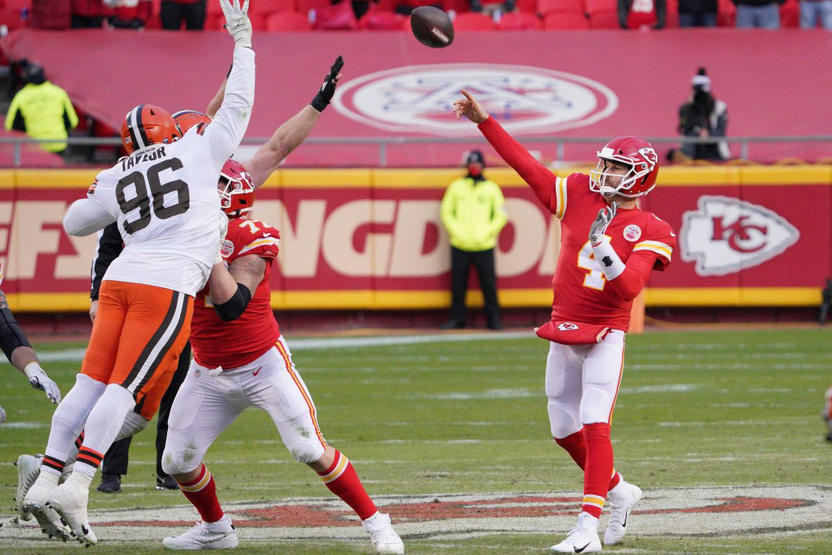 Kansas City Chiefs quarterback Chad Henne (4) throws against the Cleveland Browns during the second half in the AFC Divisional Round playoff game at Arrowhead Stadium.