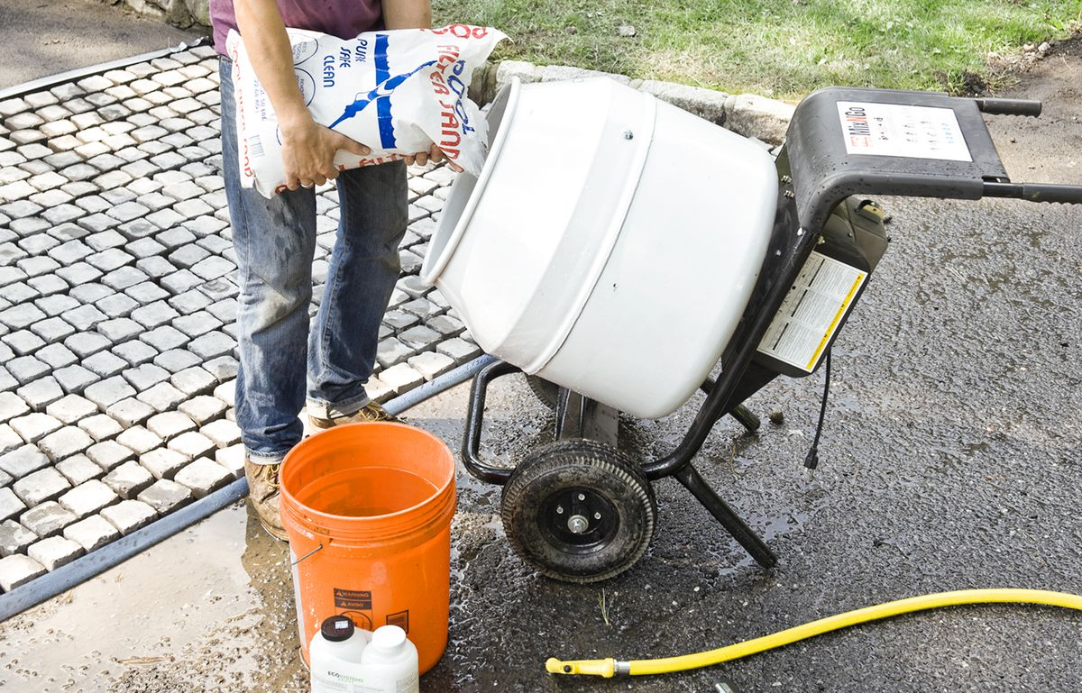 Man Mixes Grout To Apply On Driveway Apron