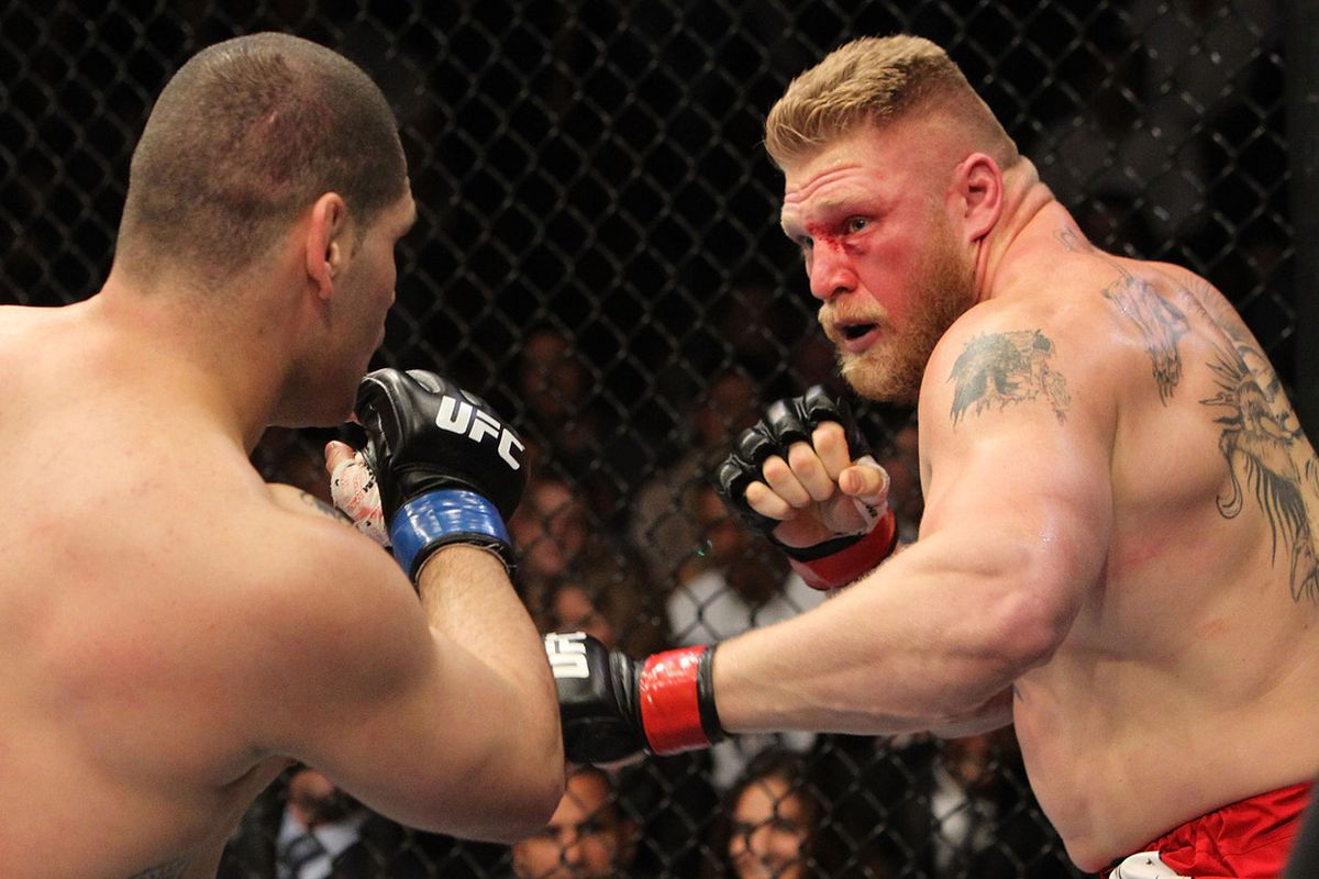 ANAHEIM, CA - OCTOBER 23: (R-L) Brock Lesnar takes on Cain Velasquez during the heavyweight title bout during UFC 121 on October 23, 2010 in Anaheim, California. (Photo by Josh Hedges/Zuffa LLC/Zuffa LLC via Getty Images)