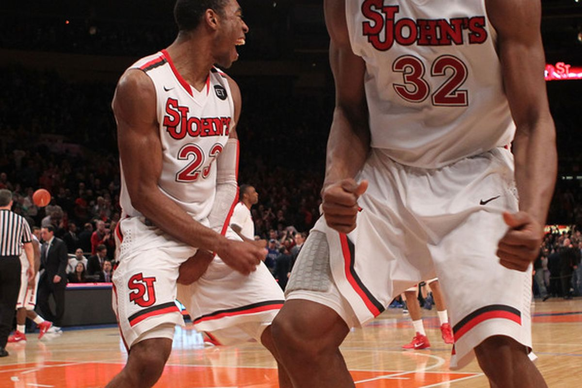 NEW YORK NY - JANUARY 30: Paris Horne #23 of the St. John's Red Storm celebrates the win with teammate Justin Brownlee #32 against the Duke Blue Devils  at Madison Square Garden on January 30 2011 in New York City.  (Photo by Nick Laham/Getty Images)