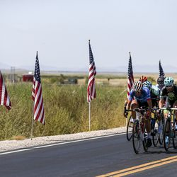 A small breakaway group exits the Antelope Island Causeway during Stage 3 of the Tour of Utah on Antelope Island on Thursday, Aug. 15, 2019.