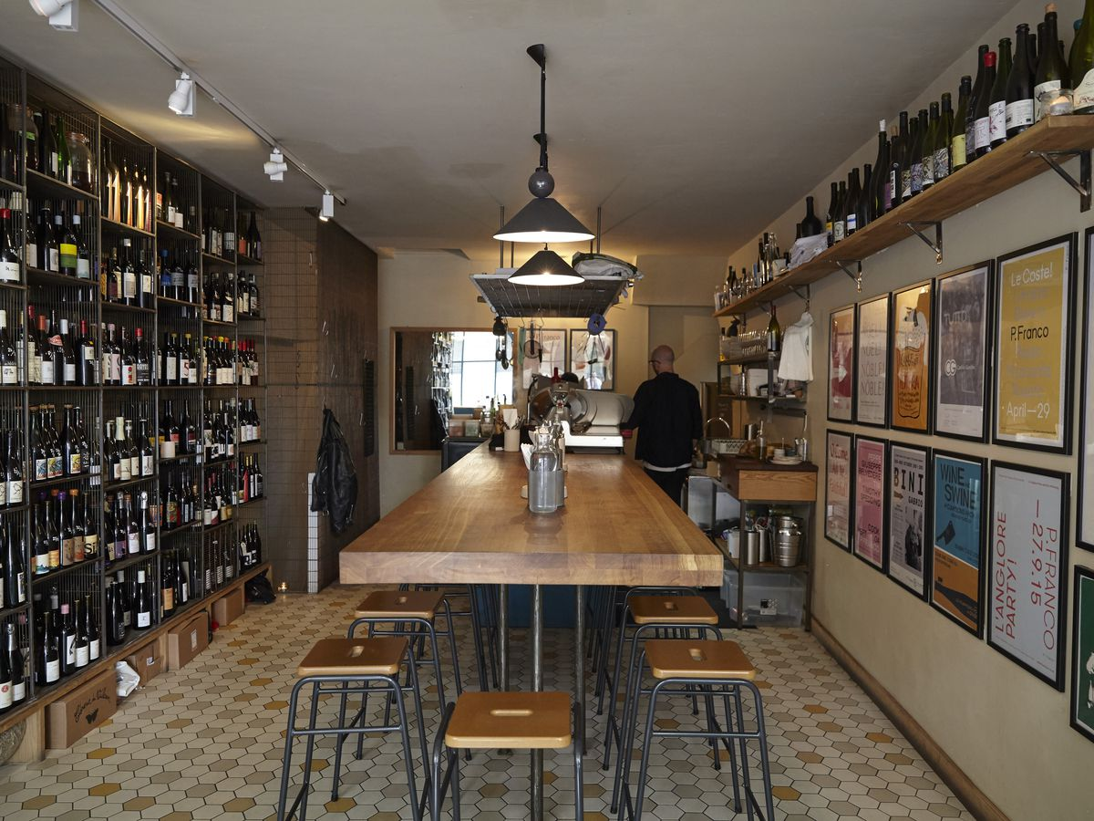 The interior of Lower Clapton wine bar and restaurant P. Franco, that forms part of the best 24 hour restaurant travel itinerary for London — where to eat with one day in the city