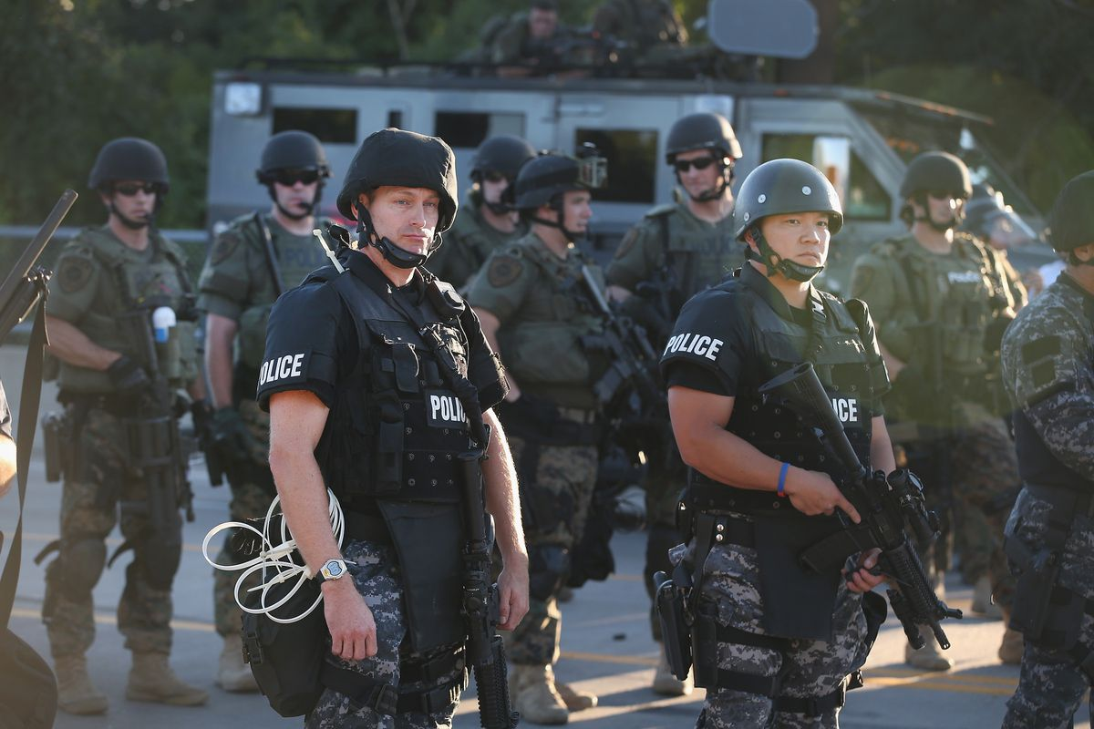 Riot police with rifles