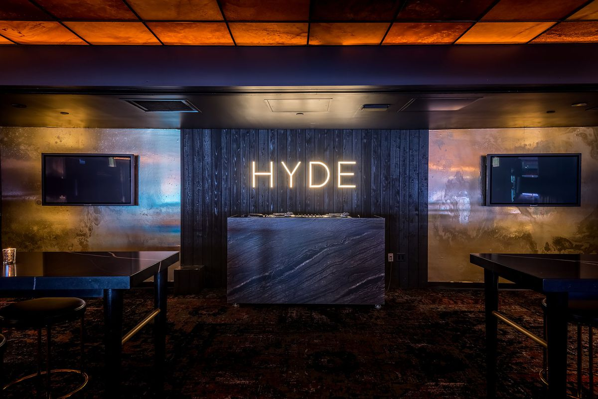 A glowing Hyde sign in front of a marble entrance.