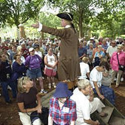 Historical interpreter Bill Barker holds a public audience as Thomas Jefferson. Some programs at the heritage site are being cut.