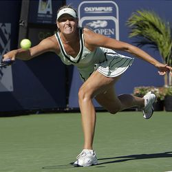 Maria Sharapova, of Russia, returns the ball to Alona Bondarenko, of Ukraine.