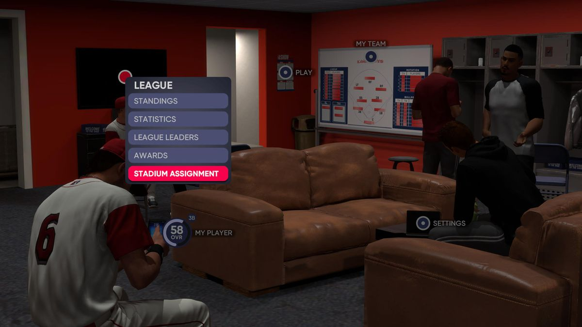 Minor league players lounge on beat up couches and look at their phones in MLB The Show 21's dingy bush-league clubhouse.