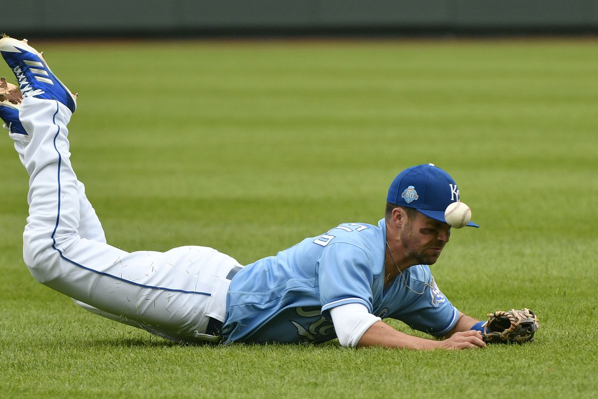 Whit Merrifield dives for a ball and misses