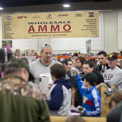 The largest crowds at the South Towne Expo Center during the 2013 Rocky Mountain Gun Show were gathered around the ammunition lines, Saturday, Jan. 5, 2013.