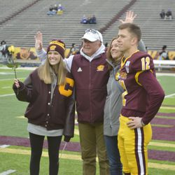 Ryan Tice poses with family during Senior Day ceremonies.