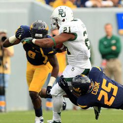 Baylor's Jarred Salubi (21) is tackled by West Virginia's Darwin Cook (25) and Karl Joseph (8) during their NCAA college football game in Morgantown, W.Va., Saturday, Sept. 29, 2012.