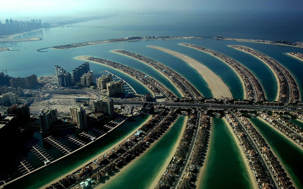 A picture shows a partial aerial view of the man-made Palm Jumeirah island built by Nakheel property giant off the coast of the Gulf emirate of Dubai on December 17, 2009. | MARWAN NAAMANI/AFP/Getty Images)