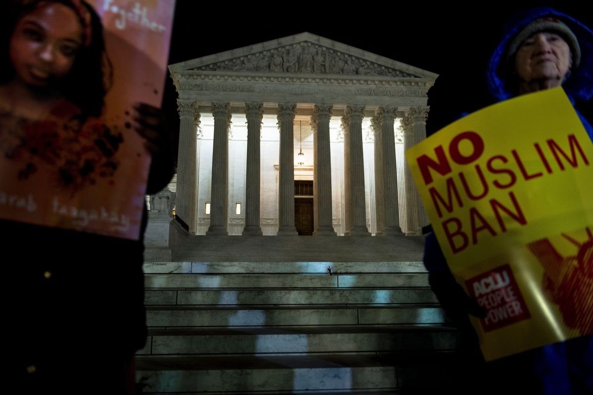 Activists protest the travel ban outside the Supreme Court in Washington, DC.